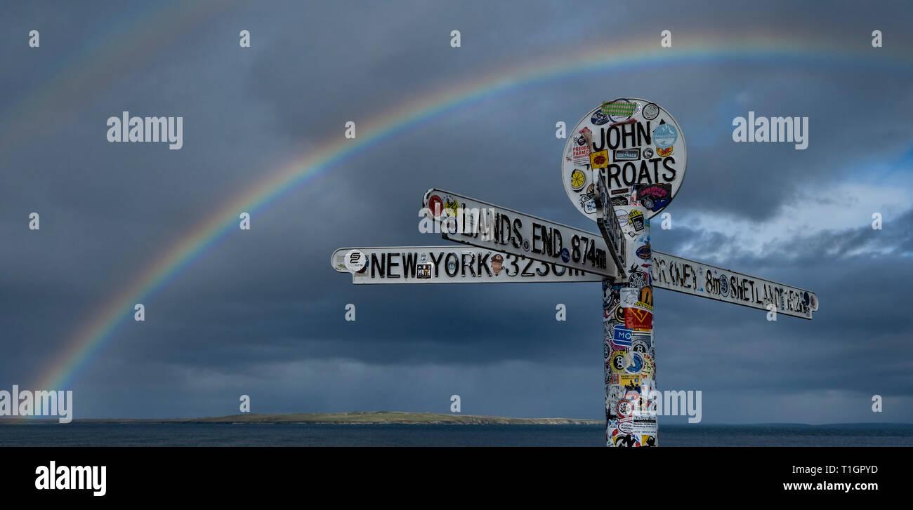 Rainbow over the John o Groats Signpost, Caithness, Highlands, Scotland, UK - Stock Image