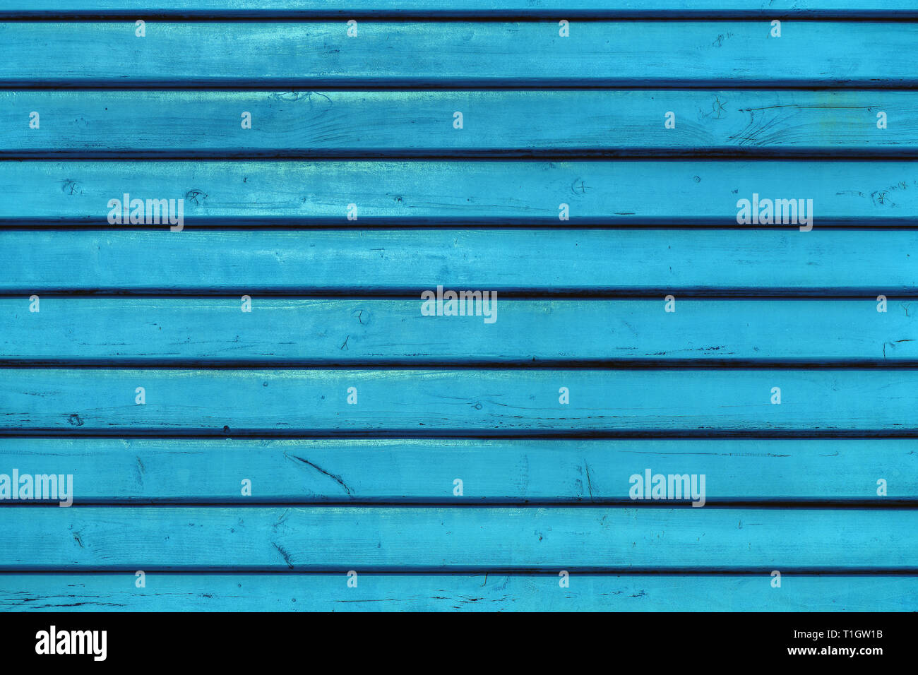 Blue vintage wooden boards in overlap cladding pattern, front view as copy space or graphic design background - Stock Image