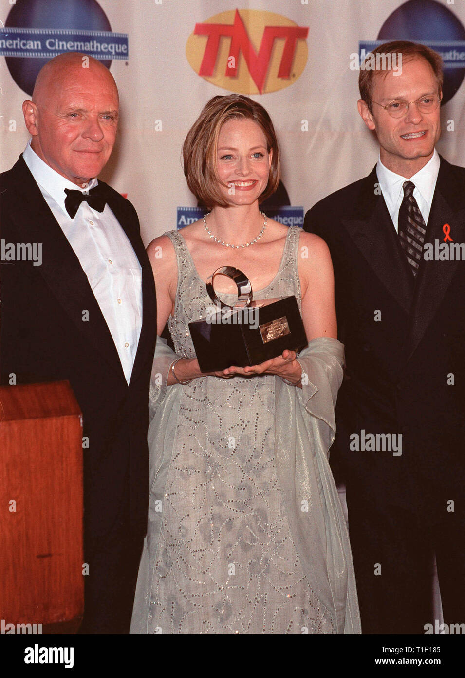 LOS ANGELES, CA. October 09, 1999:  Actors Anthony Hopkins (left) & David Hyde Pierce With Actress/director Jodie Foster at the 1999 American Cinematheque Moving Picture Ball at which she was honored. © Paul Smith / Featureflash - Stock Image