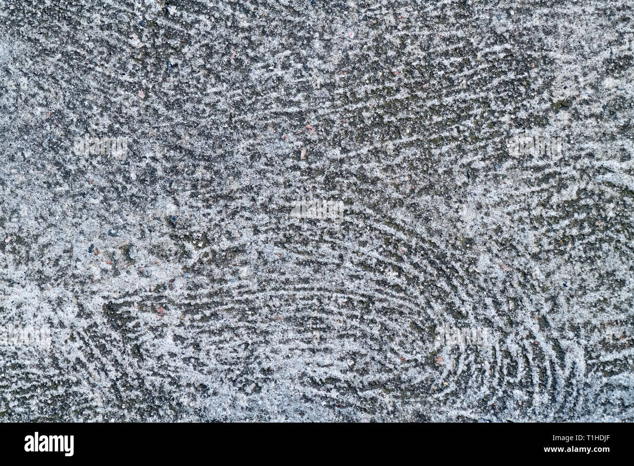 Swirly trowel marks in a cement surface. Concept rough surface, rough surface texture. - Stock Image