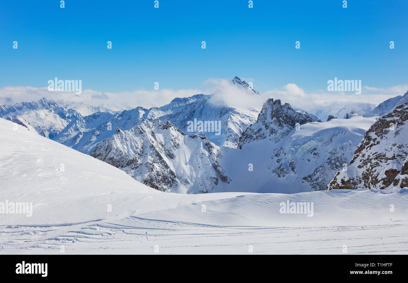 View from Mt. Titlis in Switzerland in winter - Stock Photo