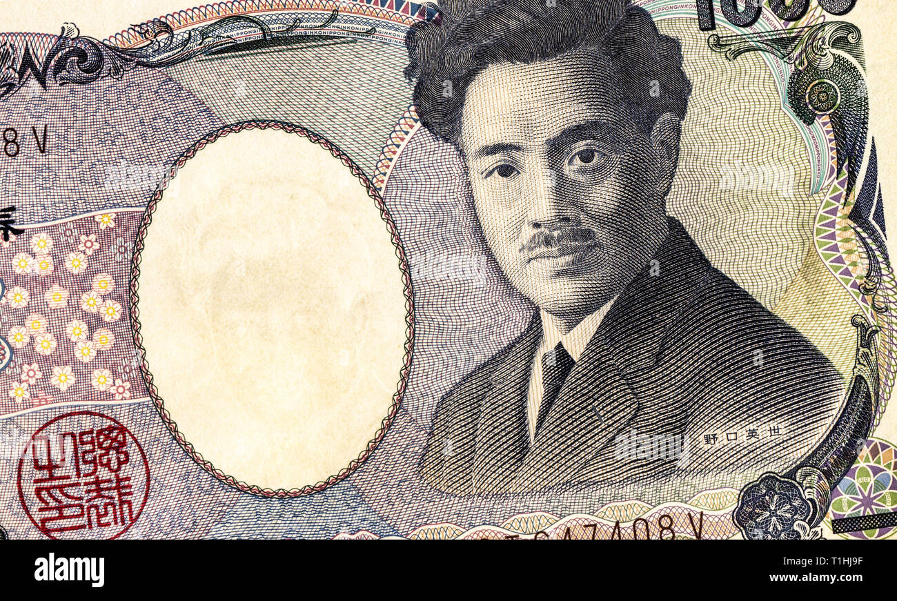 Japanese currency 1000 yen banknote with portrait of Hideyo Noguchi, detail. Yen is the official currency of Japan - Stock Image
