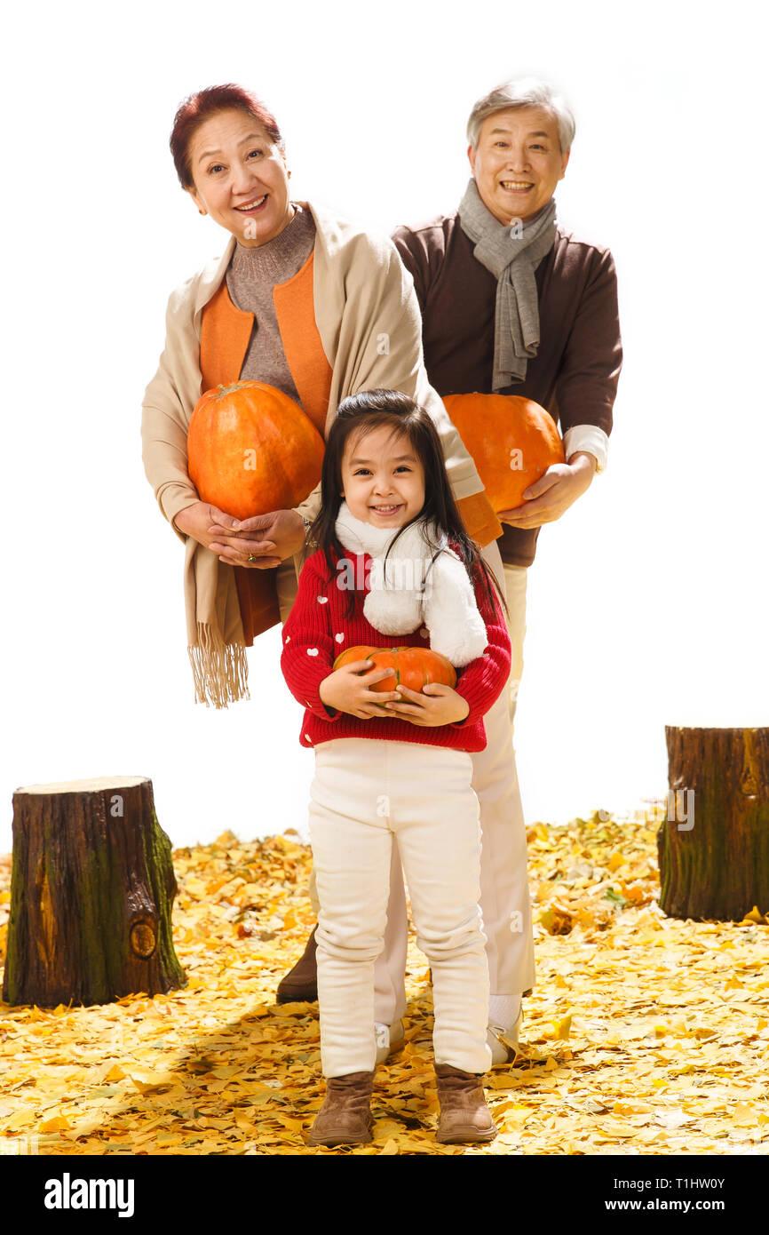 Grandchildren and pumpkin Stock Photo