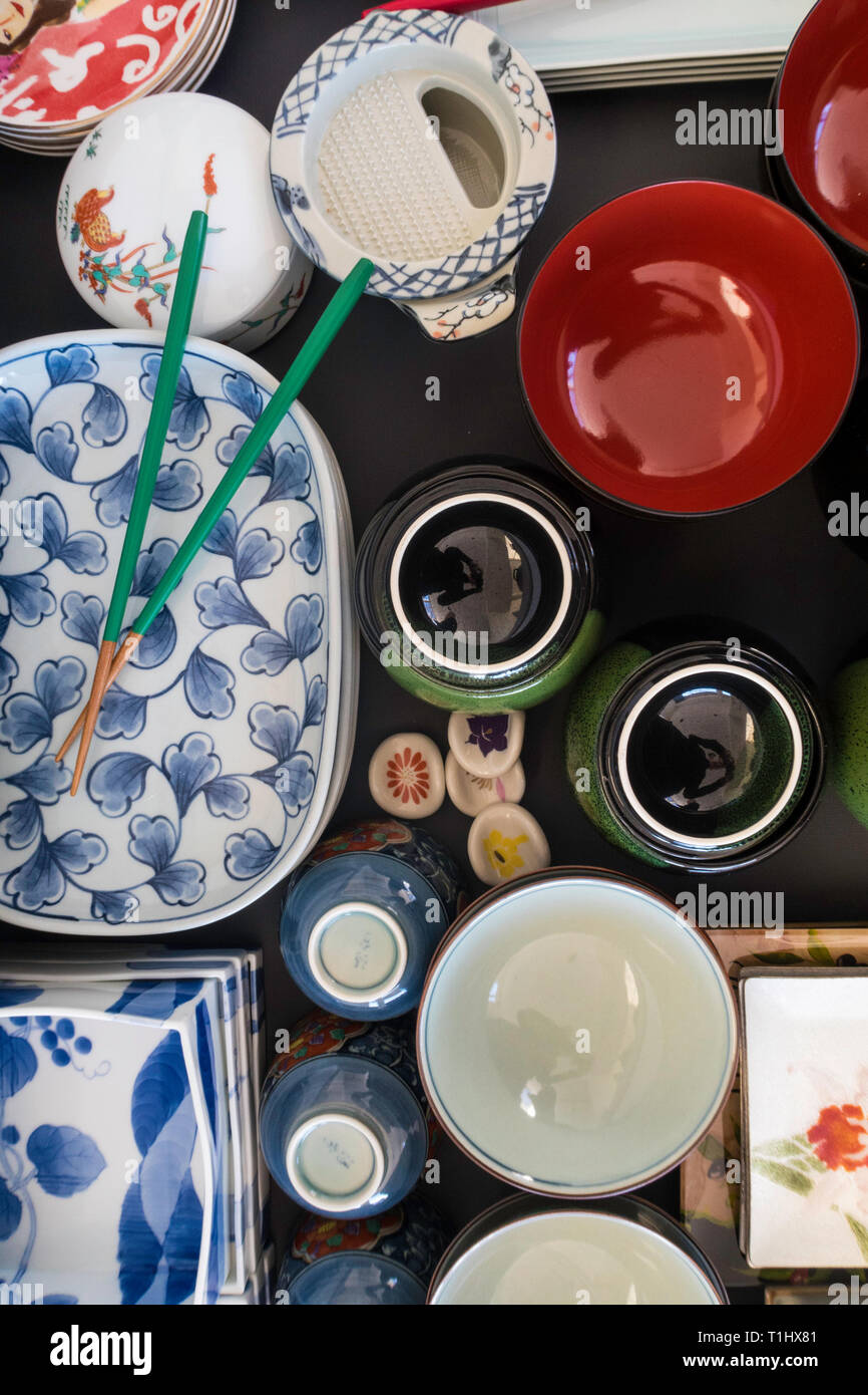 Stacked and organized Japanese plates of various shapes and sizes, USA Stock Photo