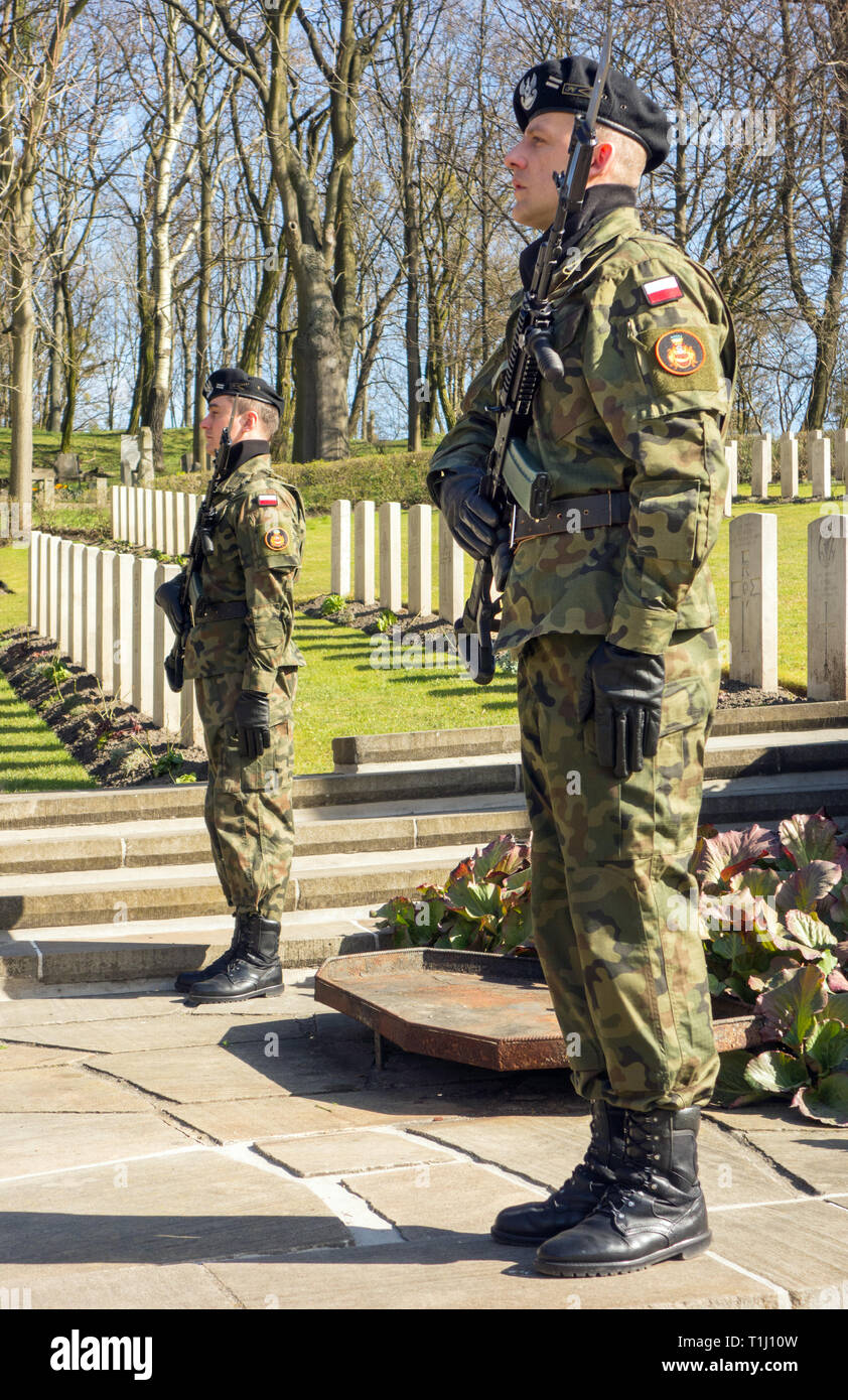 Guard of honour for the 50 airmen killed in the great escape from Stalag 3 on the 75th anniversary at the war cemetery at Poznan Poland - Stock Image