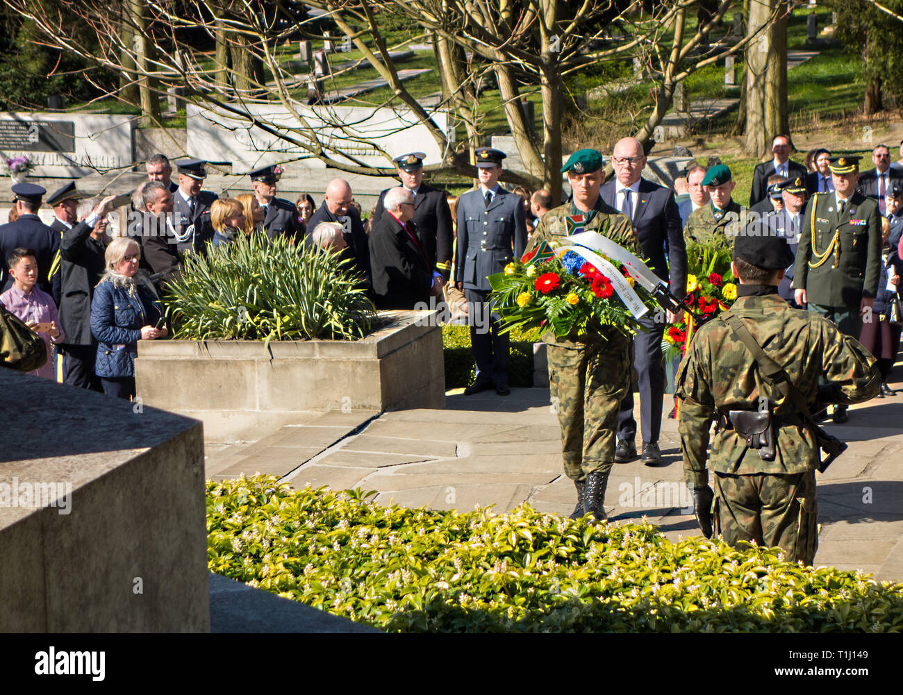 Laying  wreath at the British war cemetery in Poznan Poland to mark the 75th anniversary of 50 airmen being killed  for their part in the great escape Stock Photo