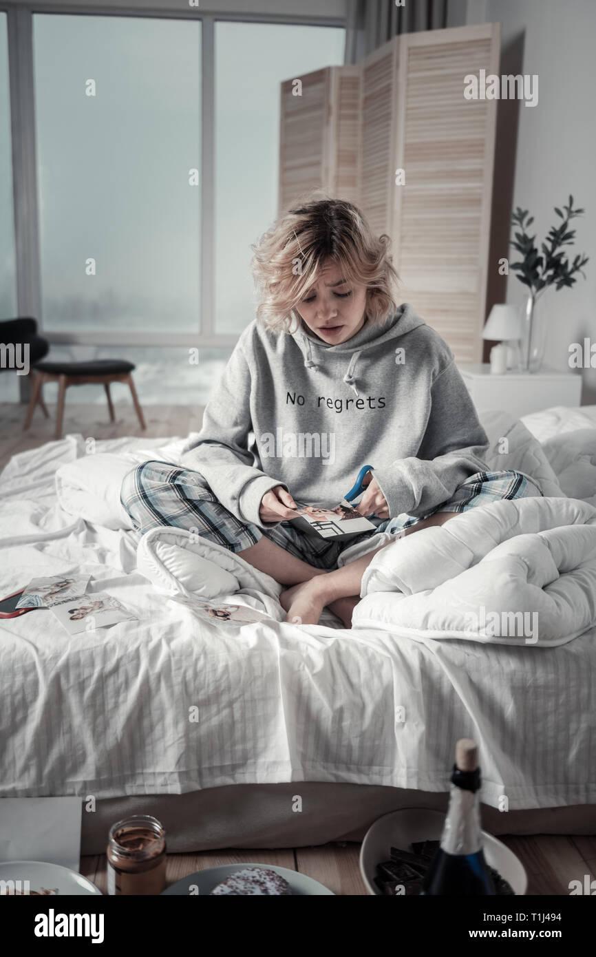 Woman feeling sentimental spending morning without boyfriend - Stock Image