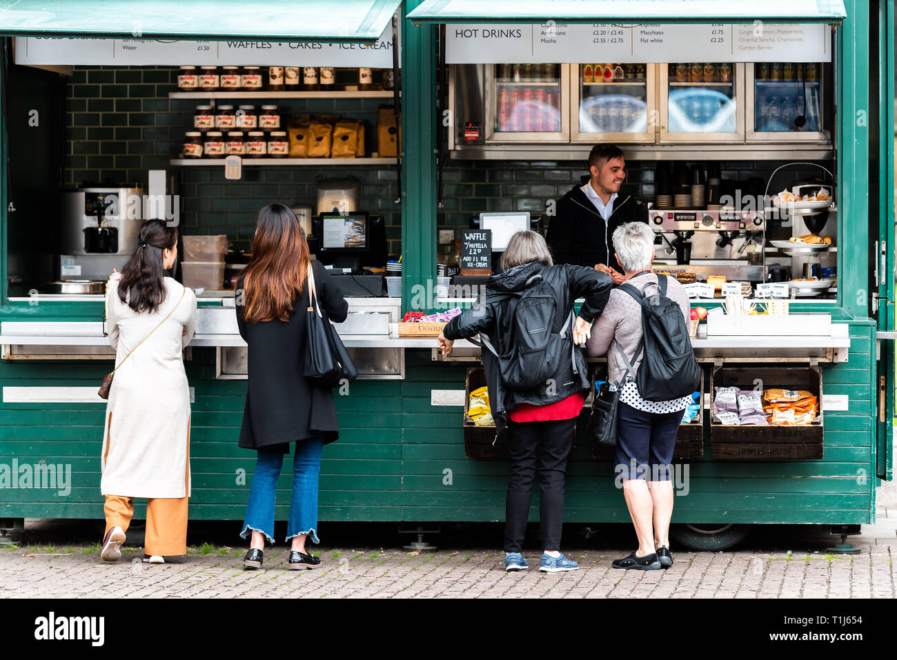 London, UK - September 12, 2018: People buying coffee or tea in morning fast food counter street outside at cafe in Chelsea United Kingdom, Great Brit - Stock Image