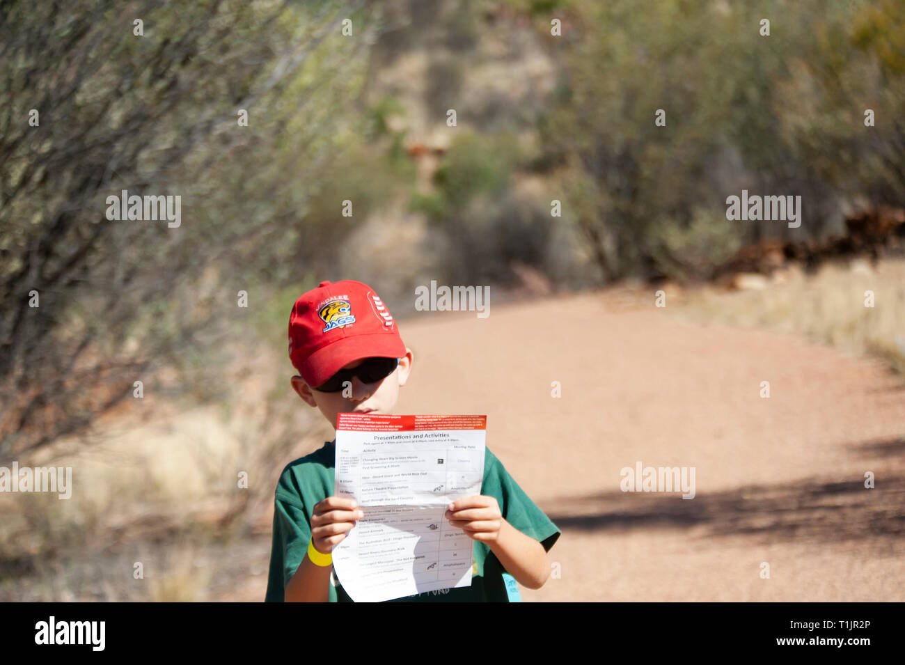Young boy exploring Alice Springs Desert Park, Alice Springs, Northern Territory, Australia - Stock Image