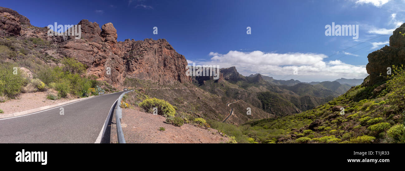 Road though volcanic landscape near Timagada on Gran Canaria, Canary Islands - Stock Image