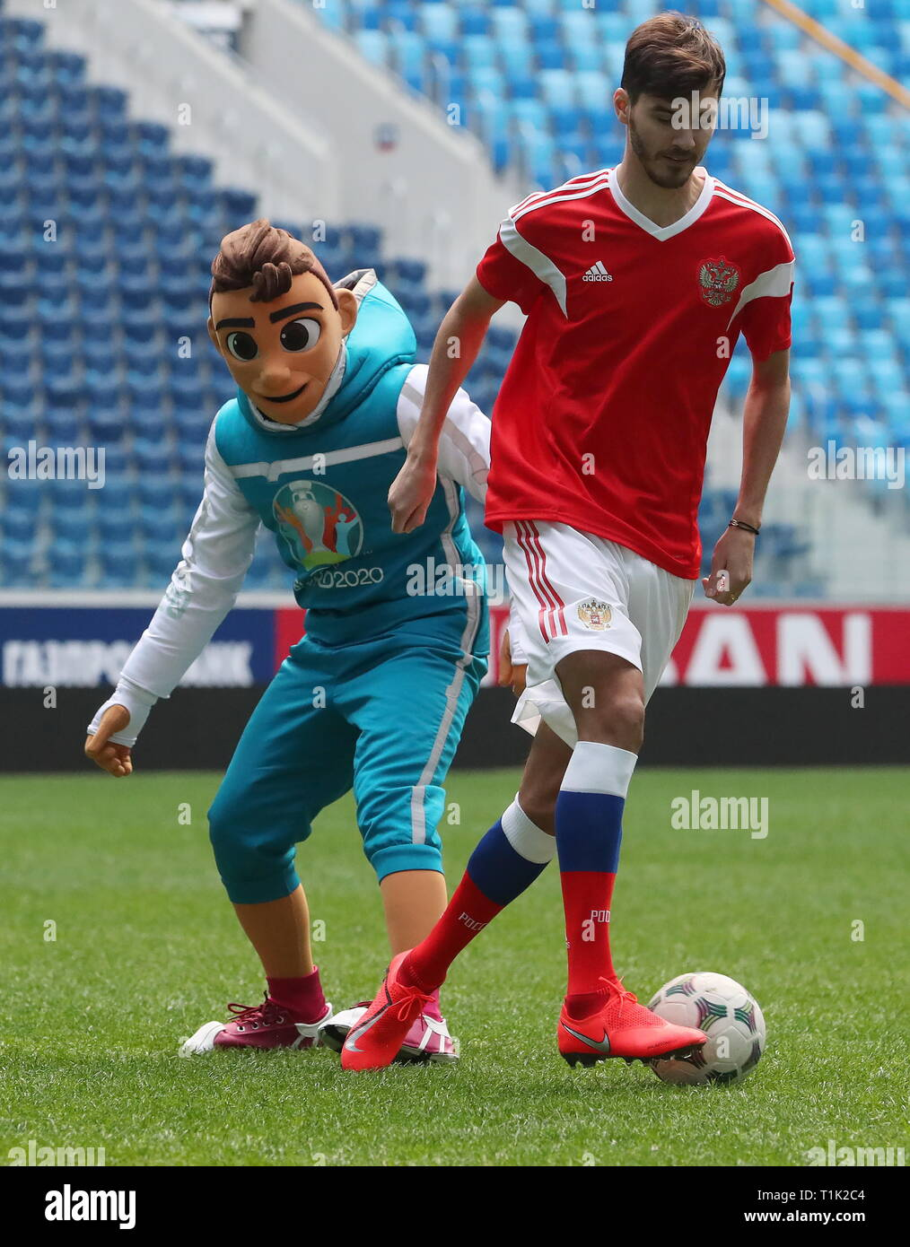 St Petersburg Russia 27th Mar 2019 St Petersburg Russia March 27 2019 Fc Zenit St Petersburg Midfielder Alexander Yerokihn And Uefa Euro 2020 Official Mascot Skillzy Play Football At Gazprom Arena