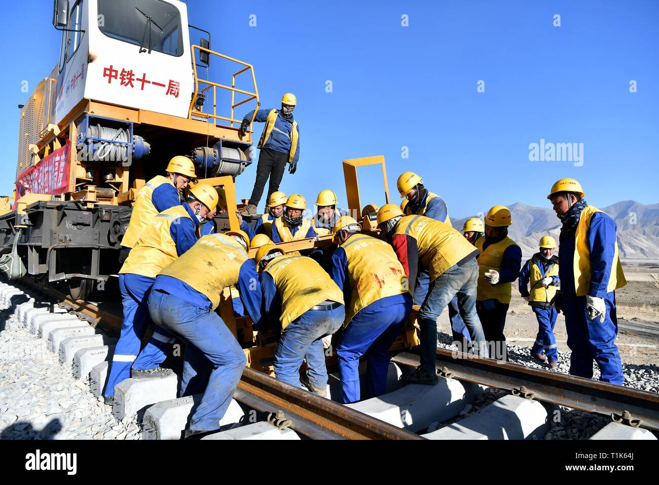 Beijing, China's Tibet Autonomous Region. 8th Mar, 2019. Workers prepare for laying the long steel rail for Lhasa-Nyingchi railway in Gonggar County of Shannan, southwest China's Tibet Autonomous Region, March 8, 2019. Credit: Li Xin/Xinhua/Alamy Live News - Stock Image