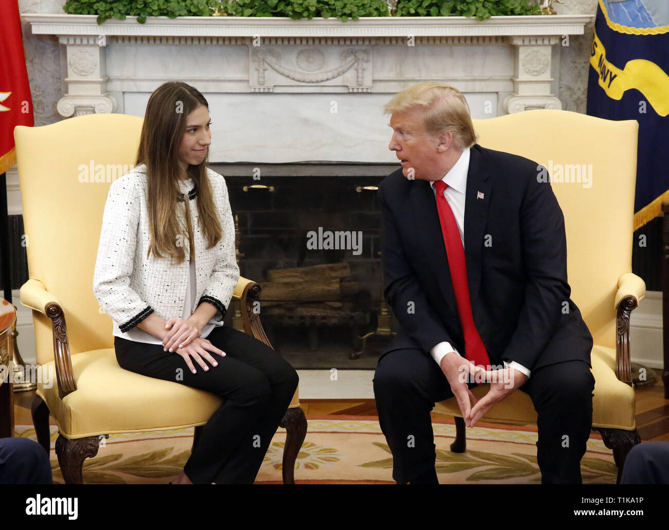 Washington, District of Columbia, USA. 27th Mar, 2019. United States President Donald J. Trump meets with Fabiana Rosales, wife of Venezuela's self-proclaimed interim president, Juan Guaido, in the Oval Office of the White House, in Washington, DC, on Wednesday, March 27, 2019 Credit: Martin H. Simon/CNP/ZUMA Wire/Alamy Live News Stock Photo
