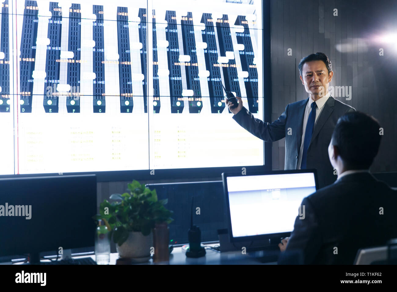 Business people in the control room Stock Photo