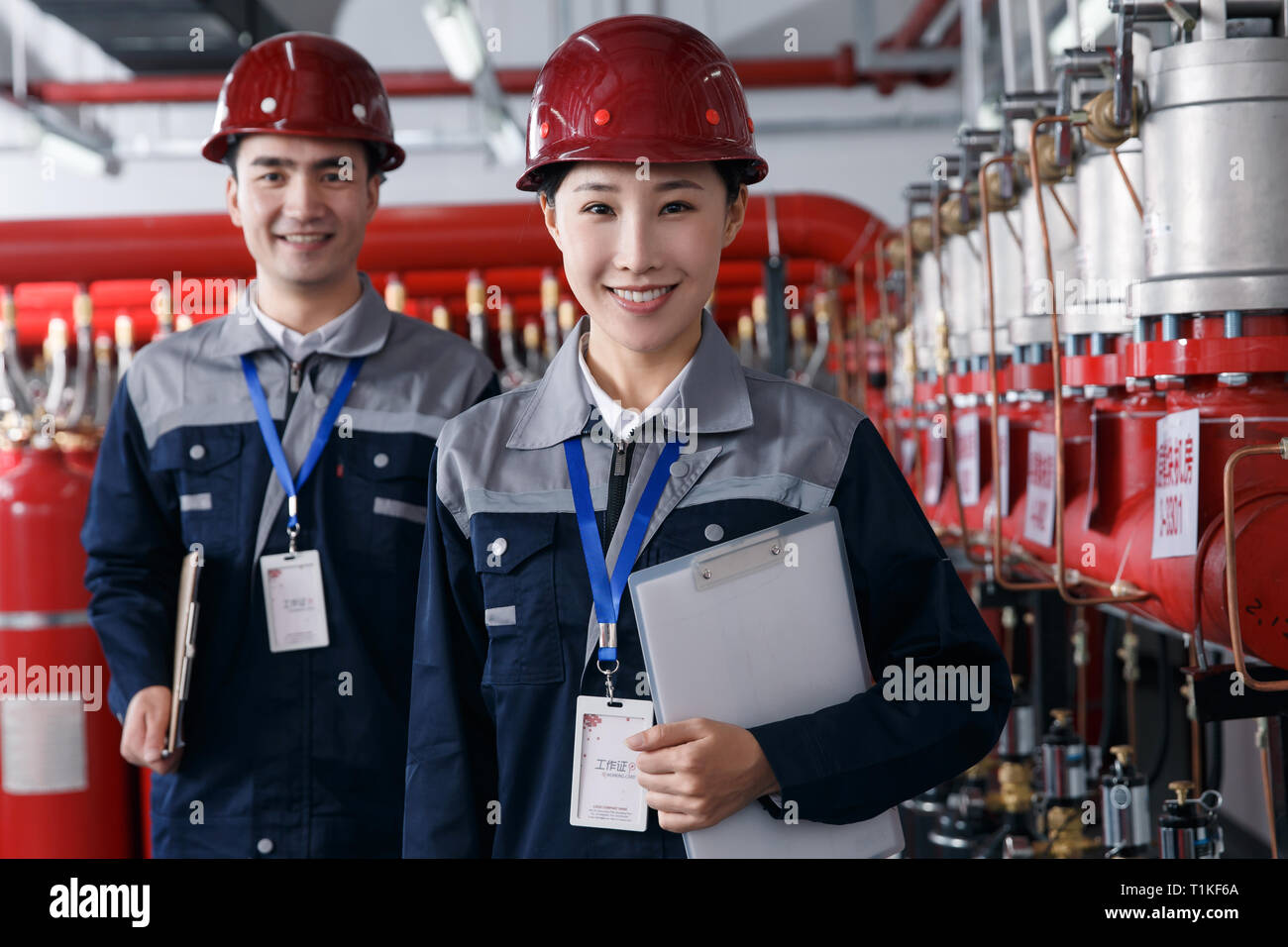 Technical personnel in the factory fire control room inspection - Stock Image