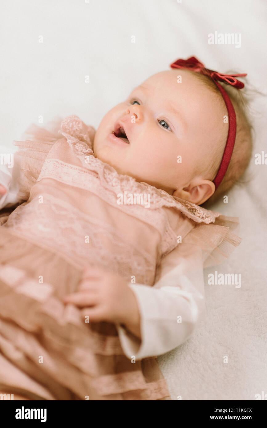Portrait of cute newborn baby girl on white on blanket Stock Photo