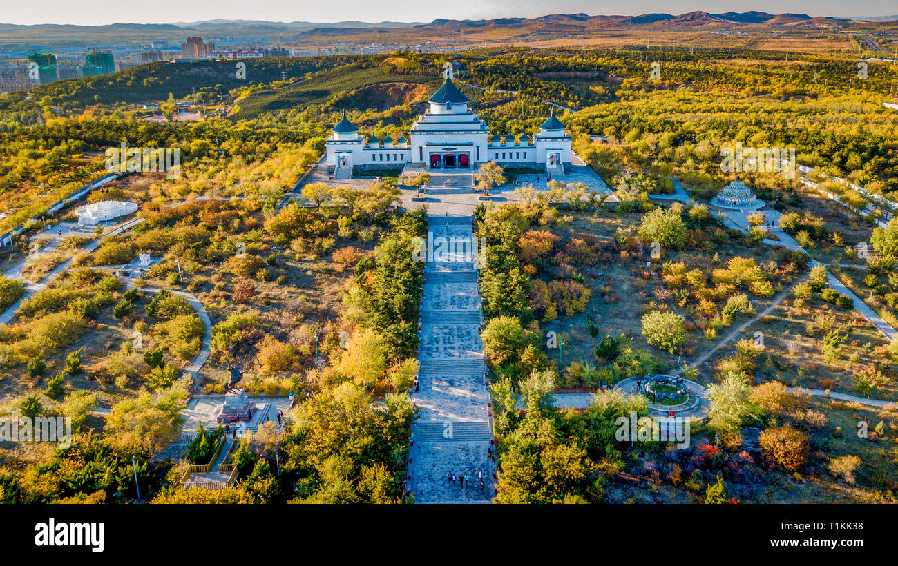 Aerial view of genghis khan temple, famous landmark, surrounded by lush greenery and beauty during sunset in autumn, in ulanhot city, inner mongolia - Stock Image
