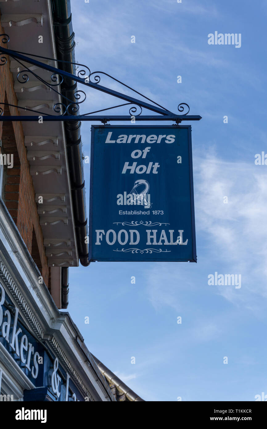 Blue hanging sign for the food hall at Larners, an upmarket retailer in Holt, Norfolk, UK - Stock Image