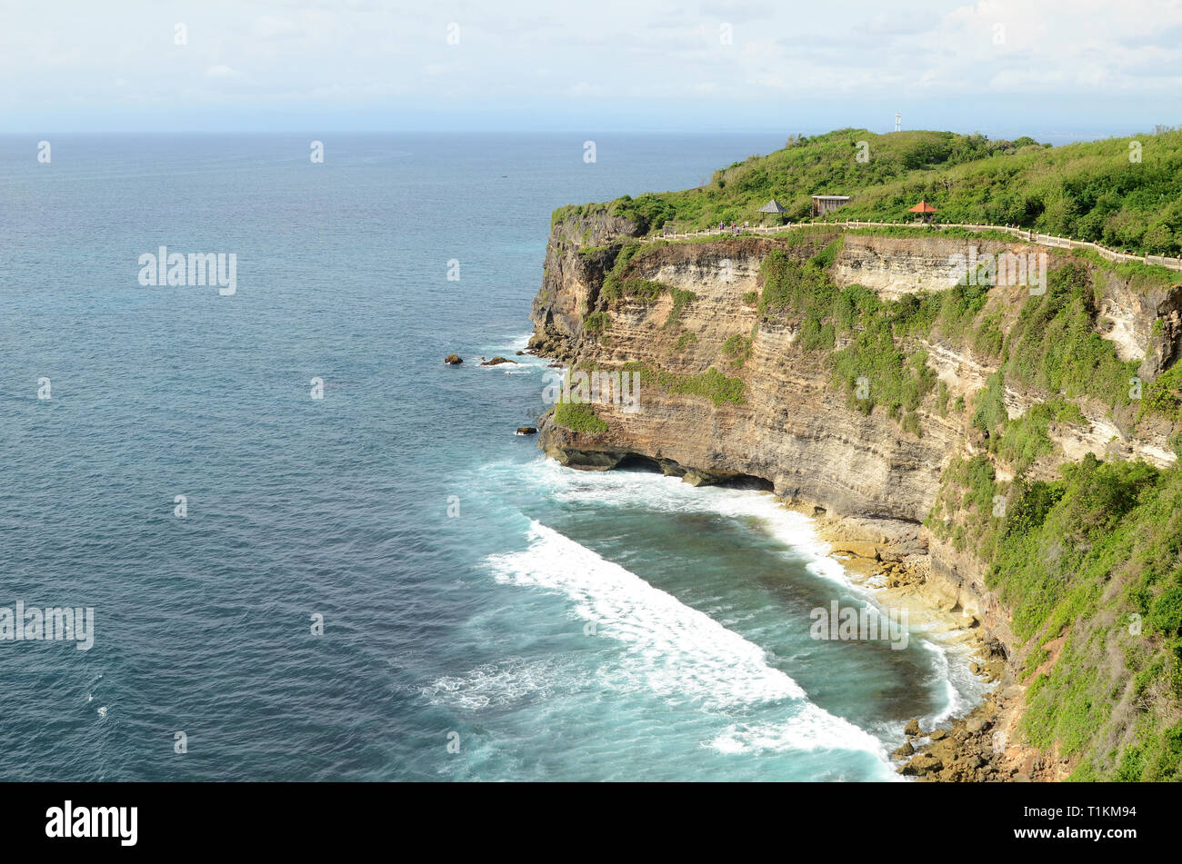 Pura Luhur Uluwatu temple in Bali, Indonesia with cliff with blue sky and sea Stock Photo