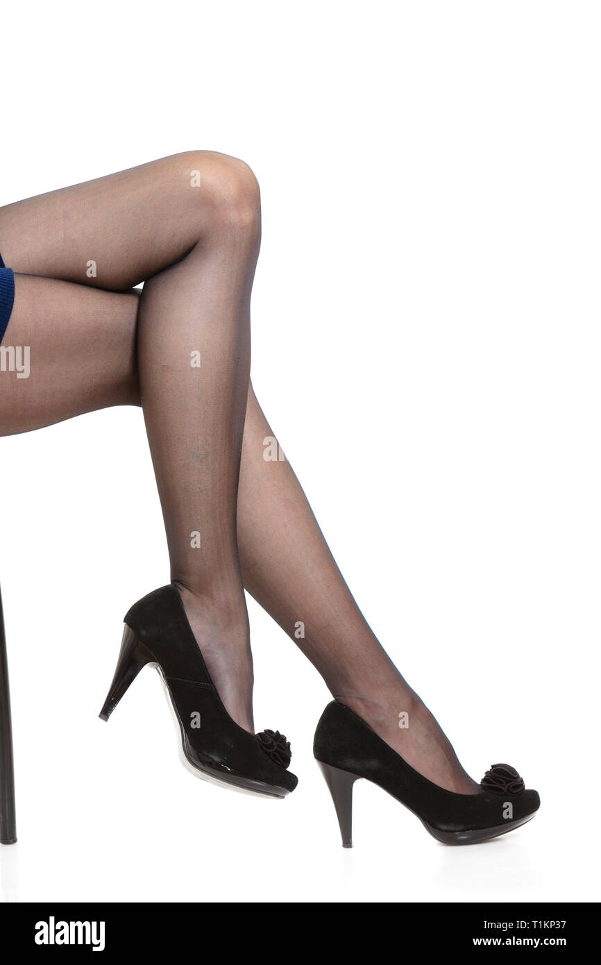 6913f44b0e121 Part body of woman. Slim attractive gorgeous female legs in black pantyhose  tights and high