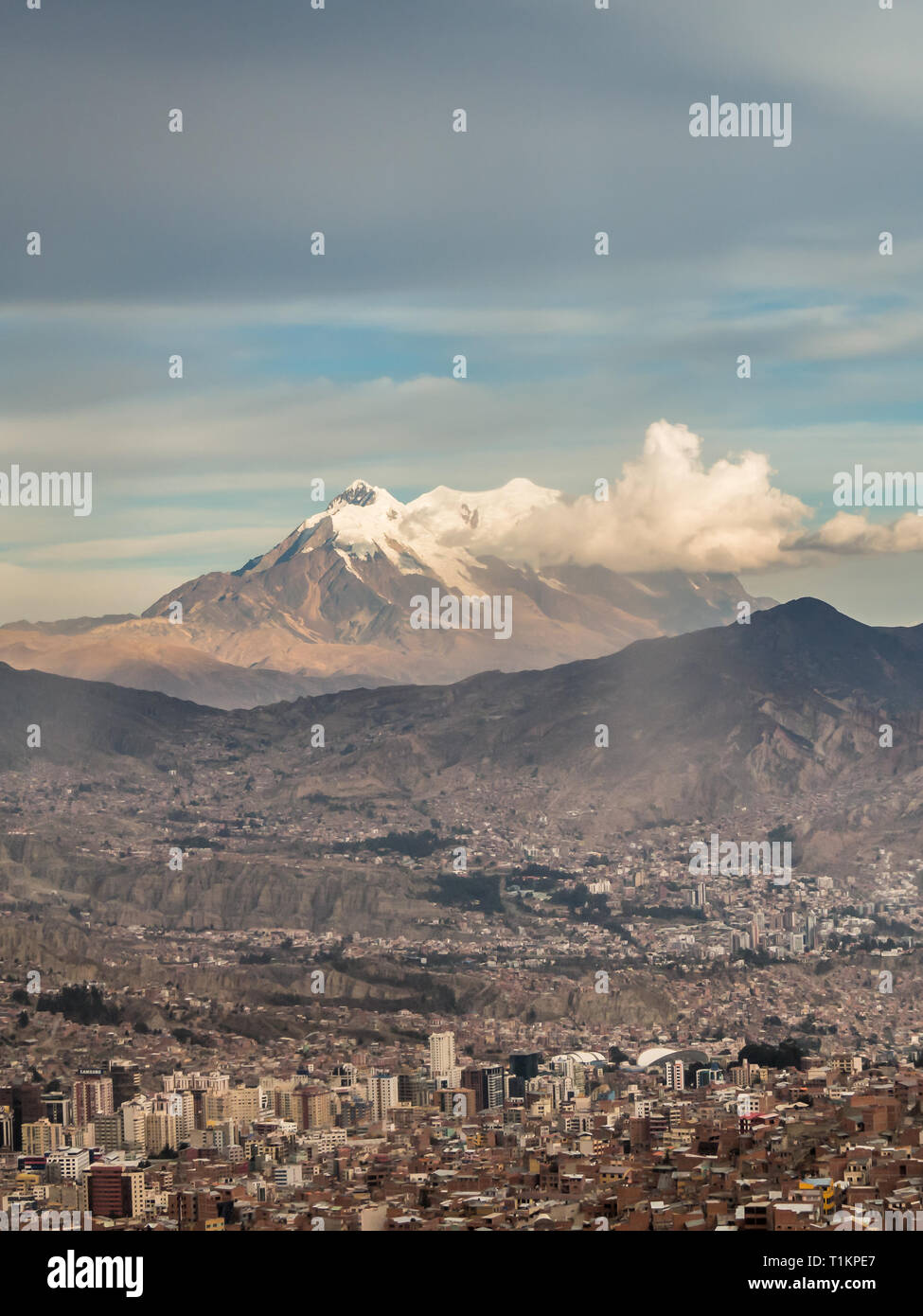 Panoramic cityscape in La Paz in Bolivia. High snow mountain in the back - Stock Image