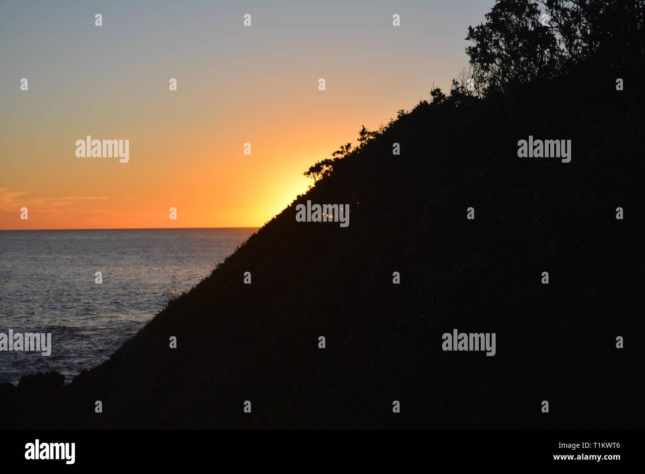 Sunrise over Pacific Ocean from Sawtell Australia - Stock Image