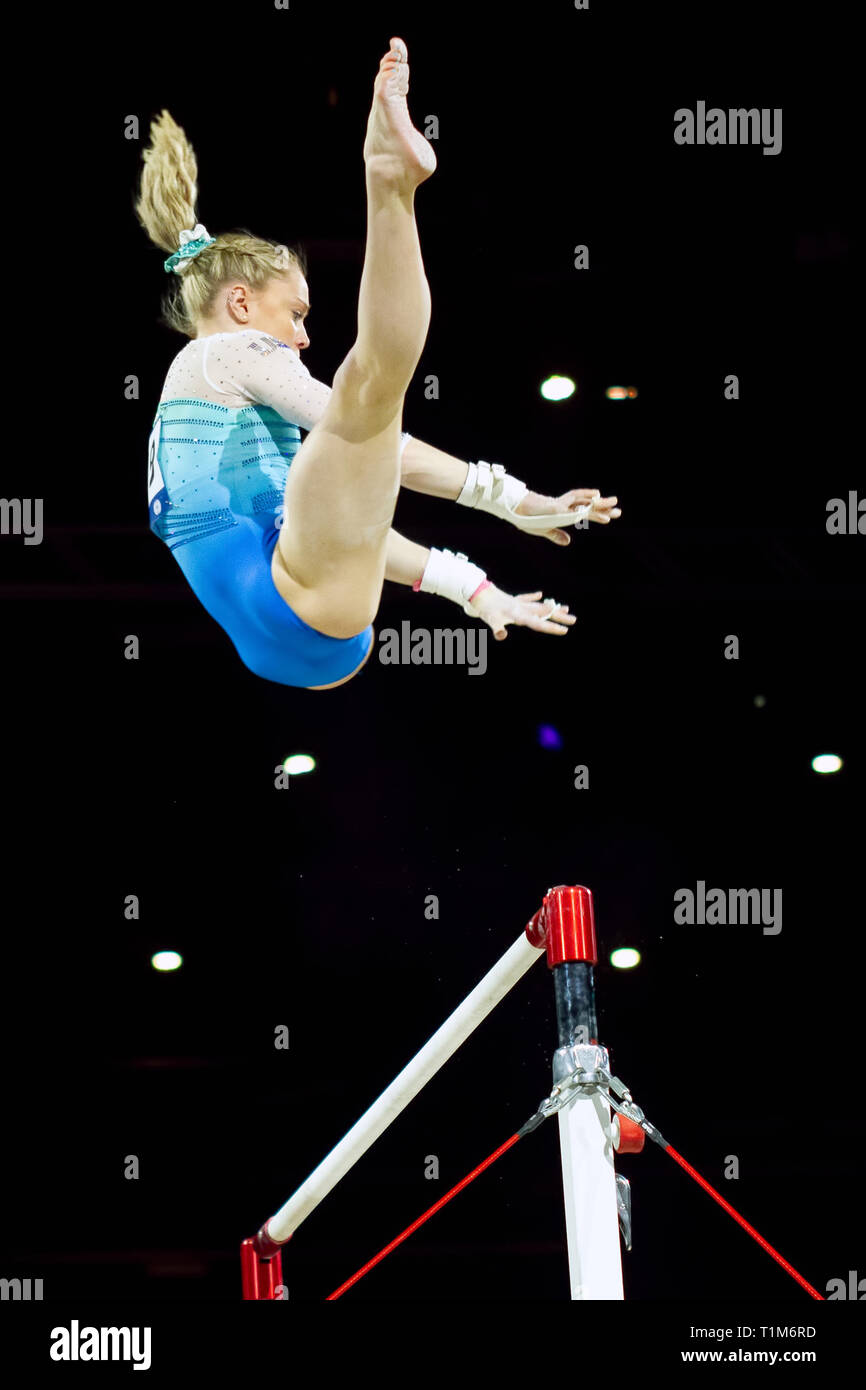 Birmingham, England, UK. 23 March, 2019. The United States' Riley McCusker in action during the women's uneven bars competition, during the 2019 Gymna - Stock Image