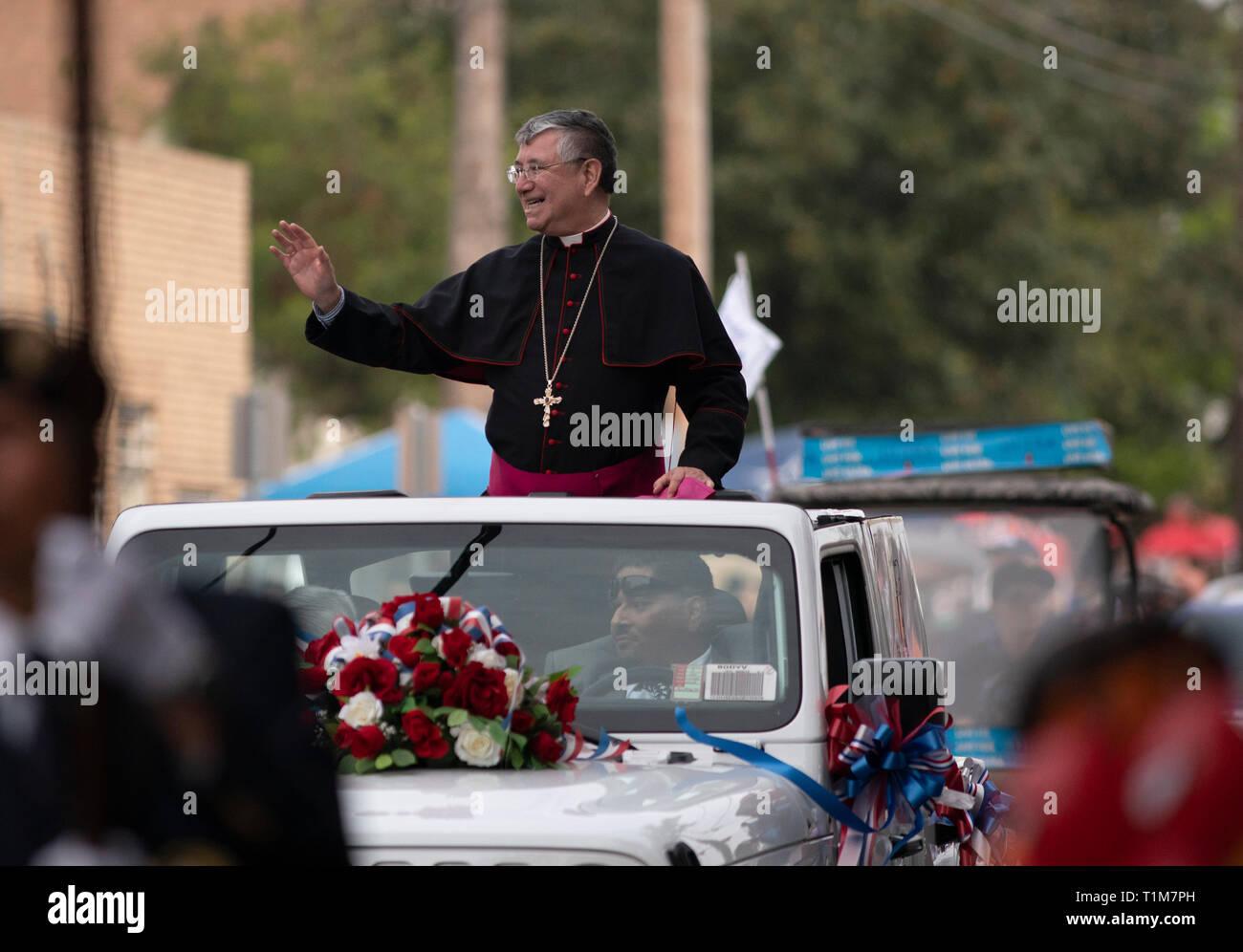 James Anthony Tamayo, bishop of the Catholic diocese of Laredo,  waves to the crowd during the Washington's Birthday Celebration parade in Laredo, TX. - Stock Image