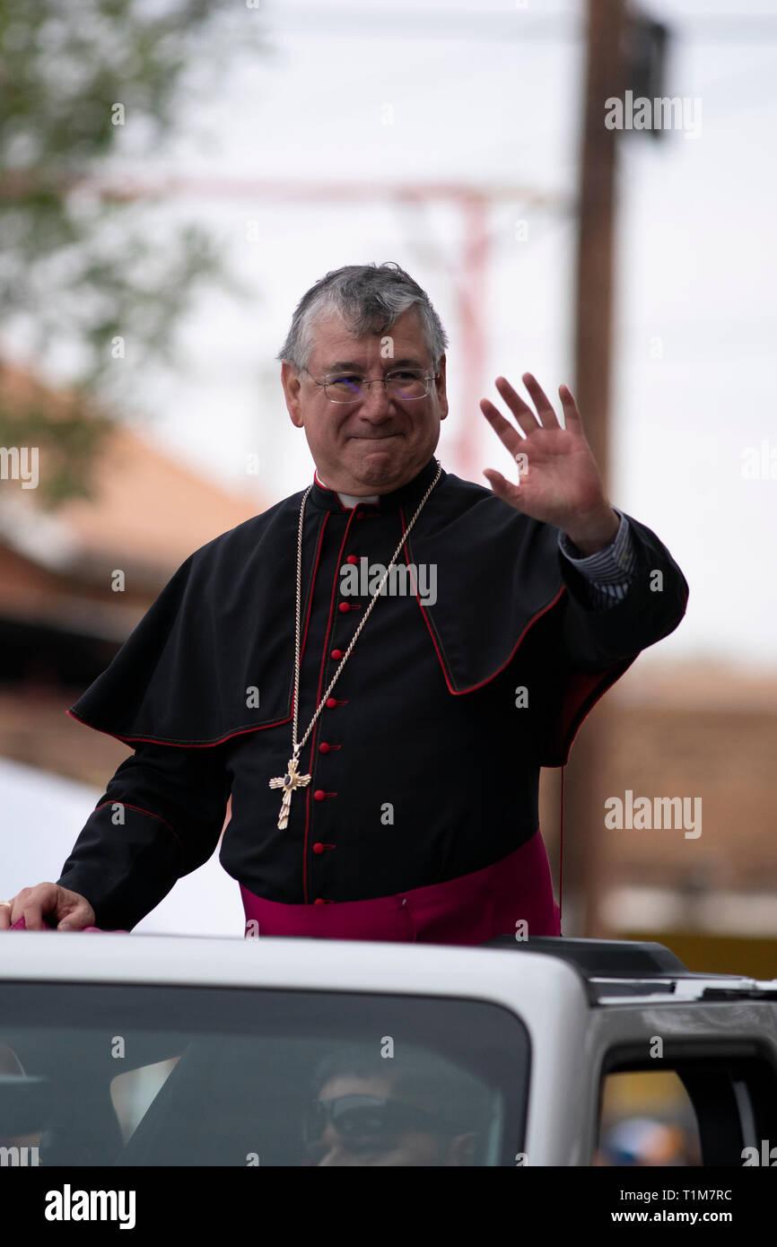 James Anthony Tamayo, bishop of the Catholic diocese of Laredo,  waves to the crowd during the Washington's Birthday Celebration parade in Laredo, TX. Stock Photo