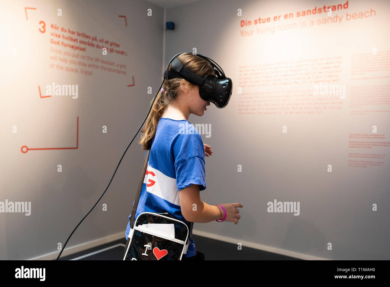 Copenhagen. Denmark. Child using a VR (virtual reality) headset to interact with an exhibit at the Danish Architecture Centre DAC, Bryghuspladsen 10. Stock Photo