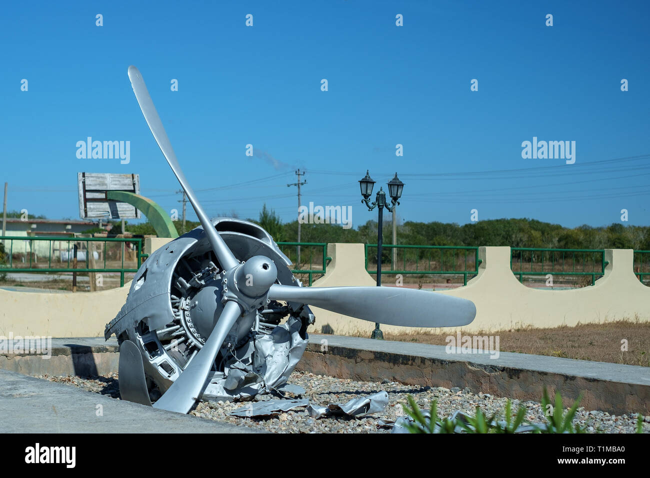 Wrecked aircraft engine and propeller at the Giron Museum, Cuba - Stock Image