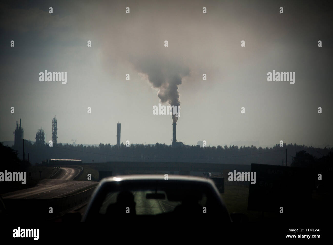 Industrial pollution in the Ribeirao Preto region, the world greatest productive pole of ethanol and sugar. Sao Paulo State, Brazil. - Stock Image