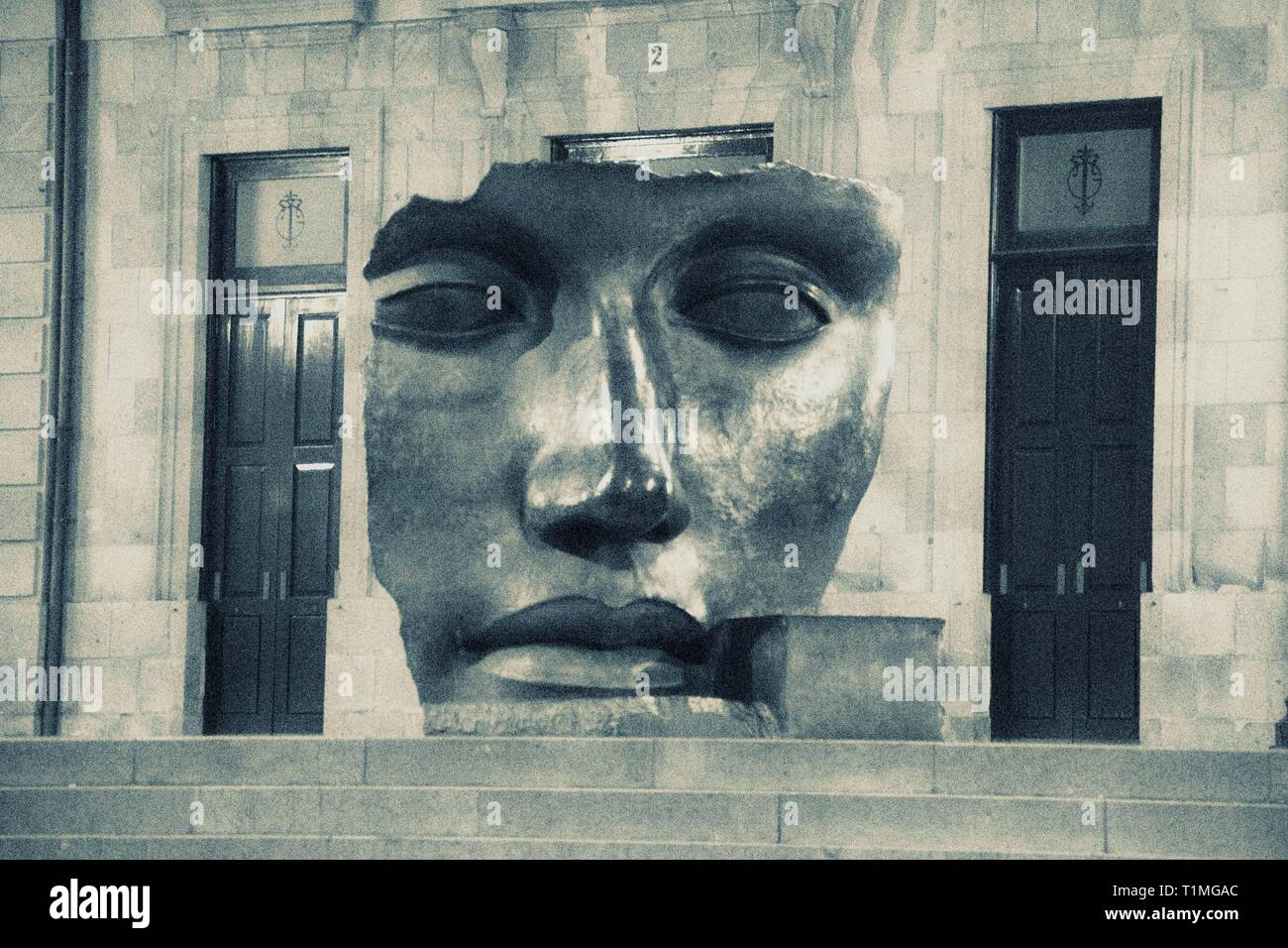 Culpture buildings with faces - Stock Image