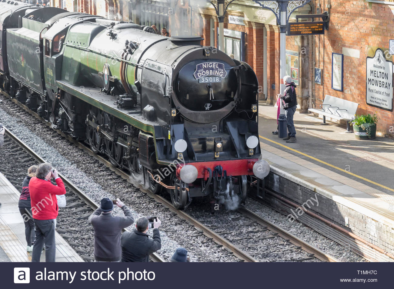 Merchant Navy Class 35018 steam train ready to depart Melton Mowbray to Kings Lynn, remembering Nigel Dobbing founder of The Railway touring company. - Stock Image