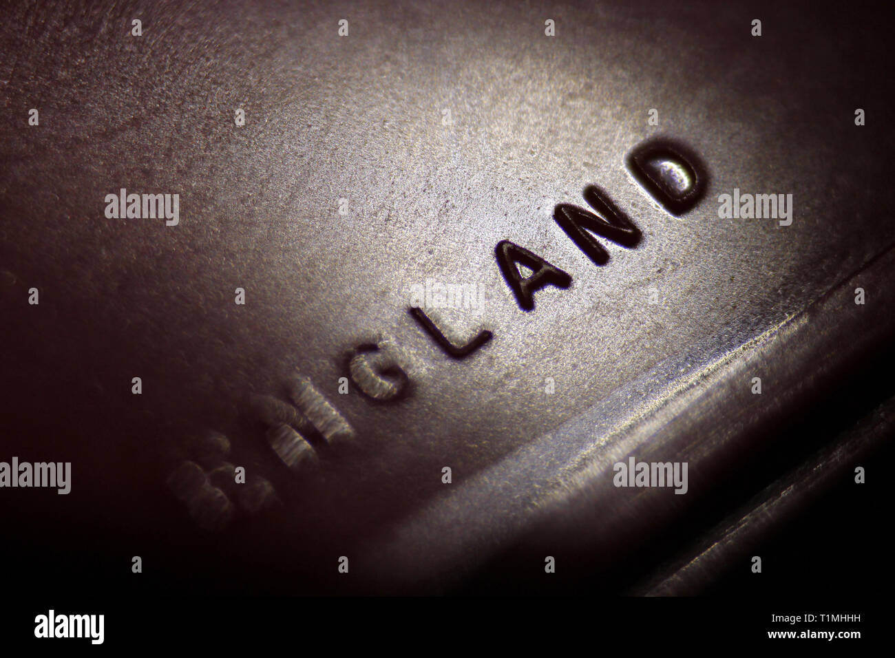 Made in England inscription relief in metal sheet, close-up - Stock Image