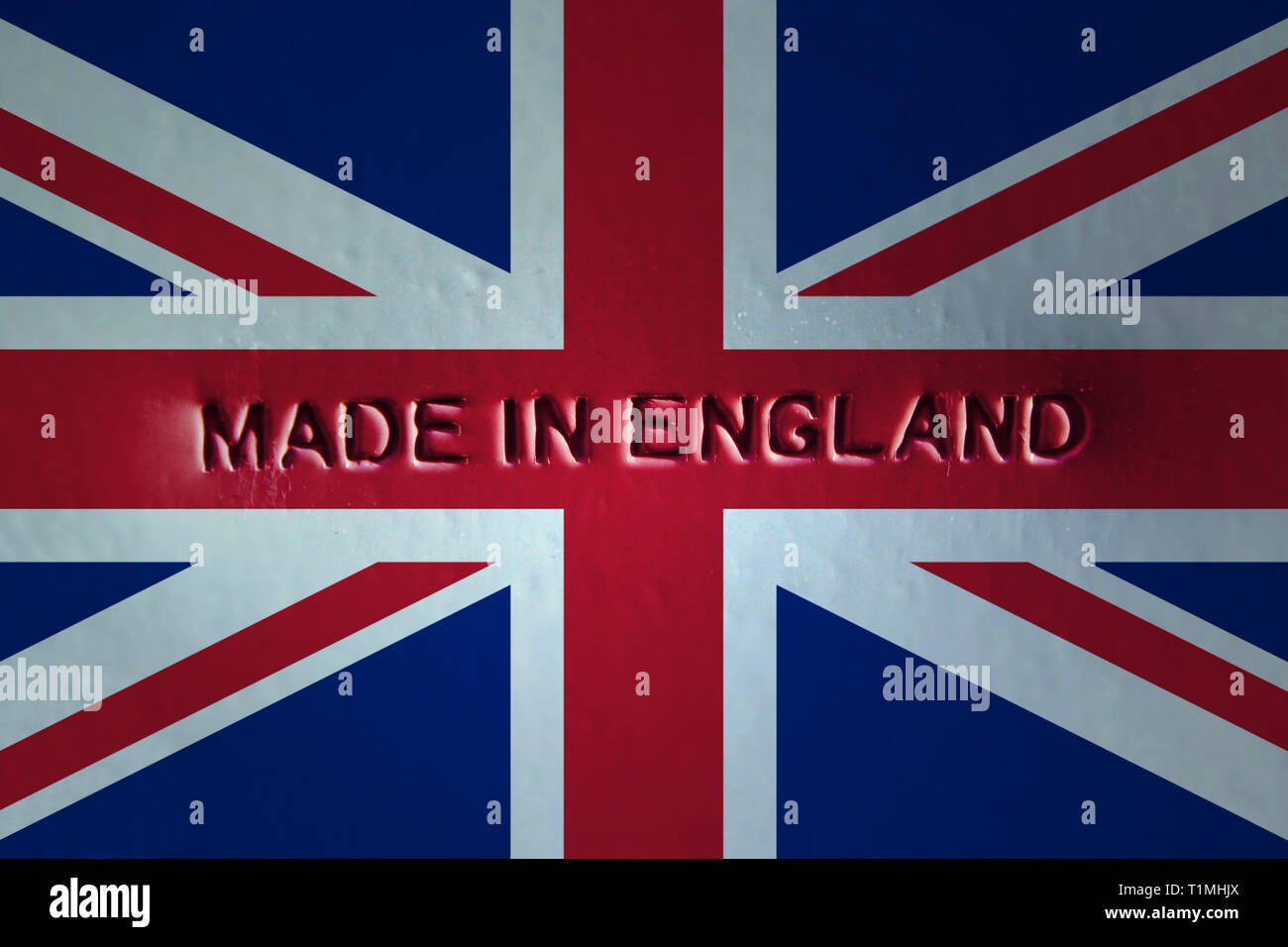 Made in England engraved in metal sheet flag, close-up - Stock Image