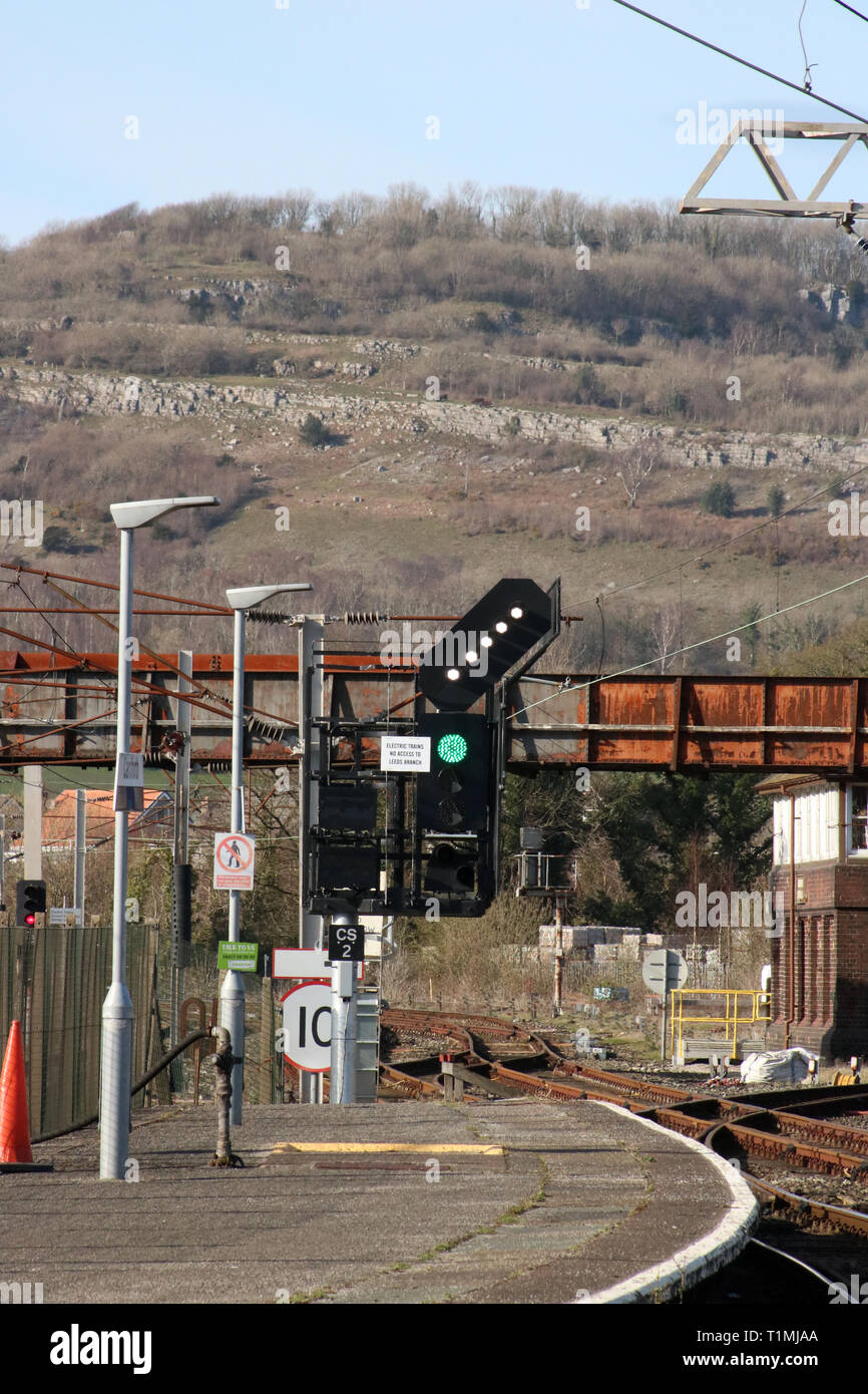 Feather direction indicator at top of color signal at end of platform 2 a Carnforth railway station showing direction to be taken by next train. Stock Photo