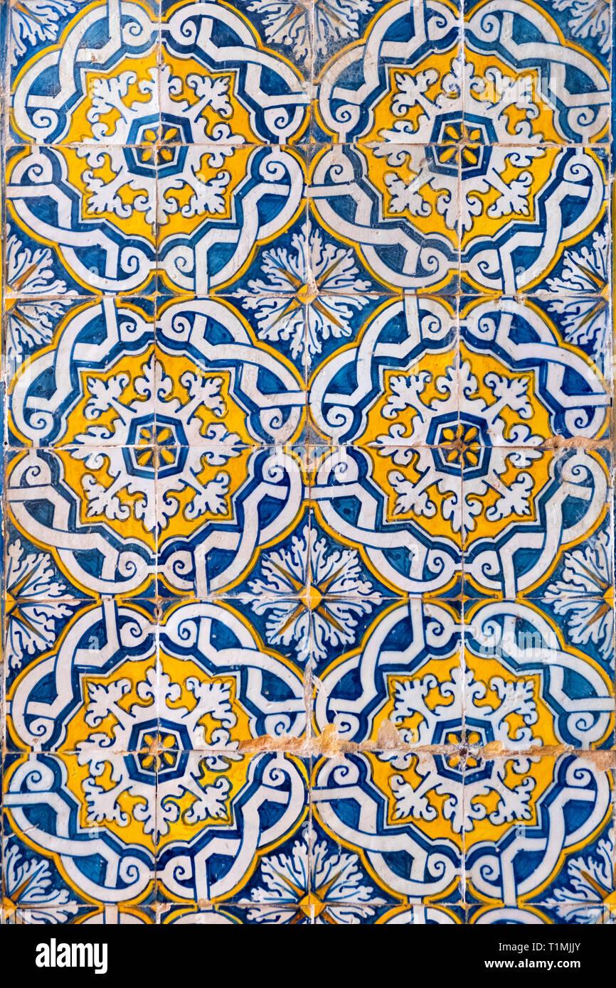 Historic 17th Century azulejo tiles in the interior courtyard of Evora University, Evora, Portugal - Stock Image