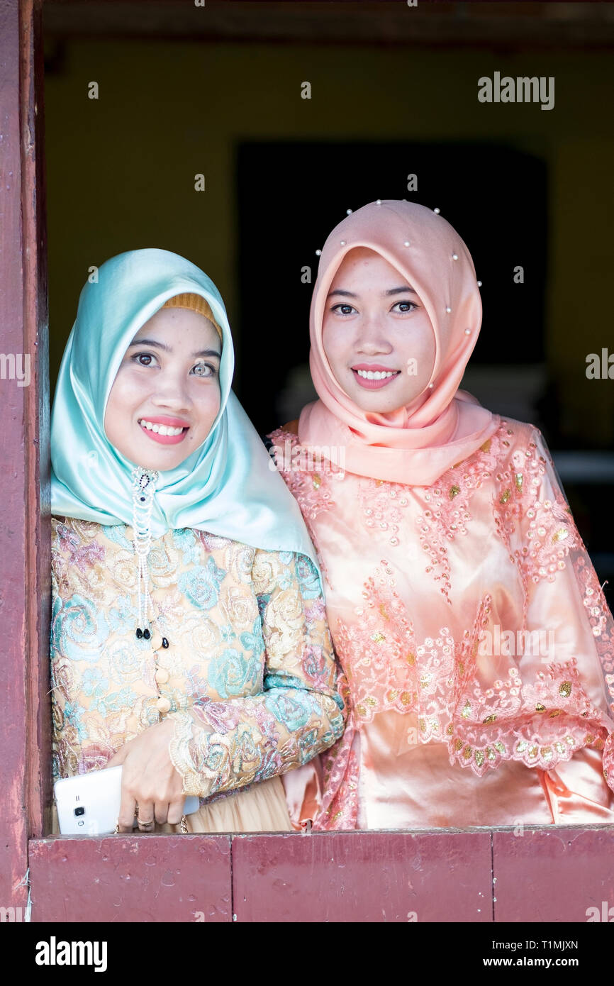 Two Muslim friends in traditional dress, Sulawesi, Indonesia Stock Photo