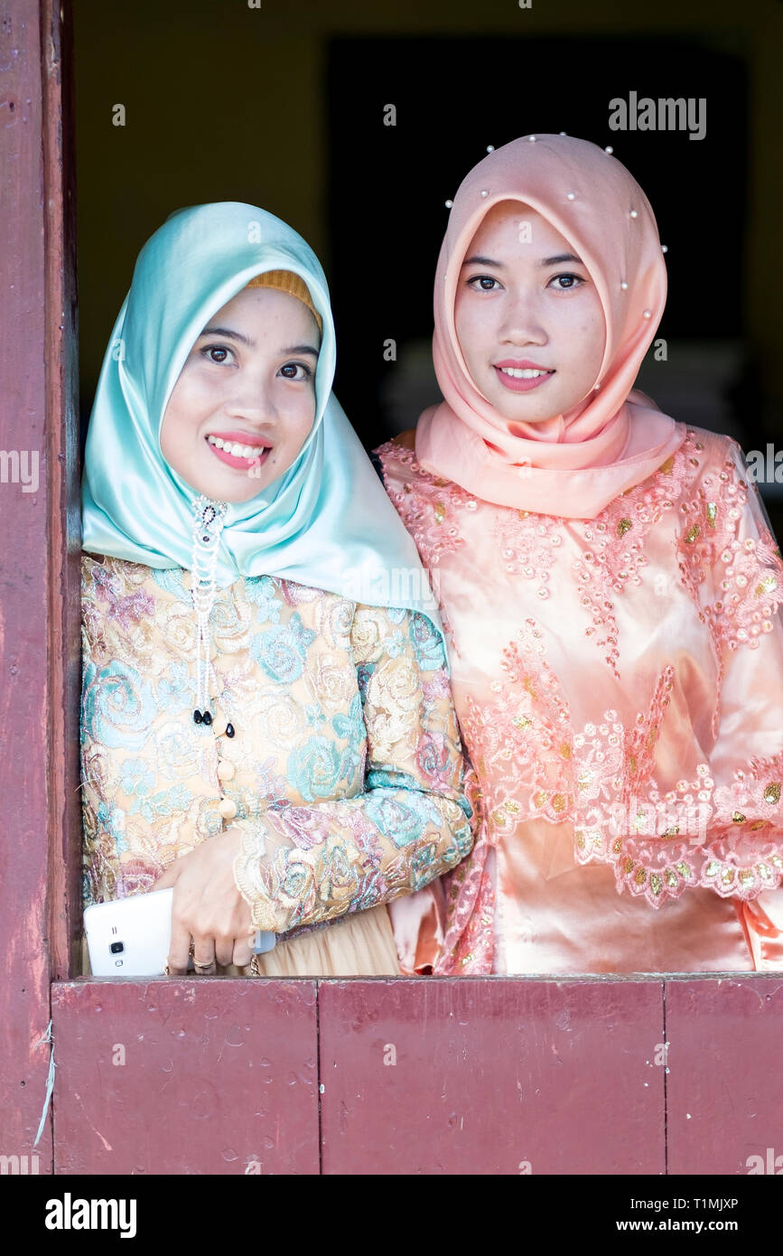 Two Muslim friends in traditional dress, Sulawesi, Indonesia - Stock Image