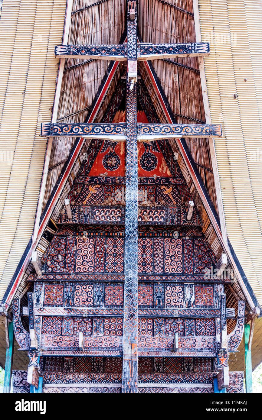 Facade of a traditional Tongokan home, decorated with cockerel and buffalo designs - Stock Image