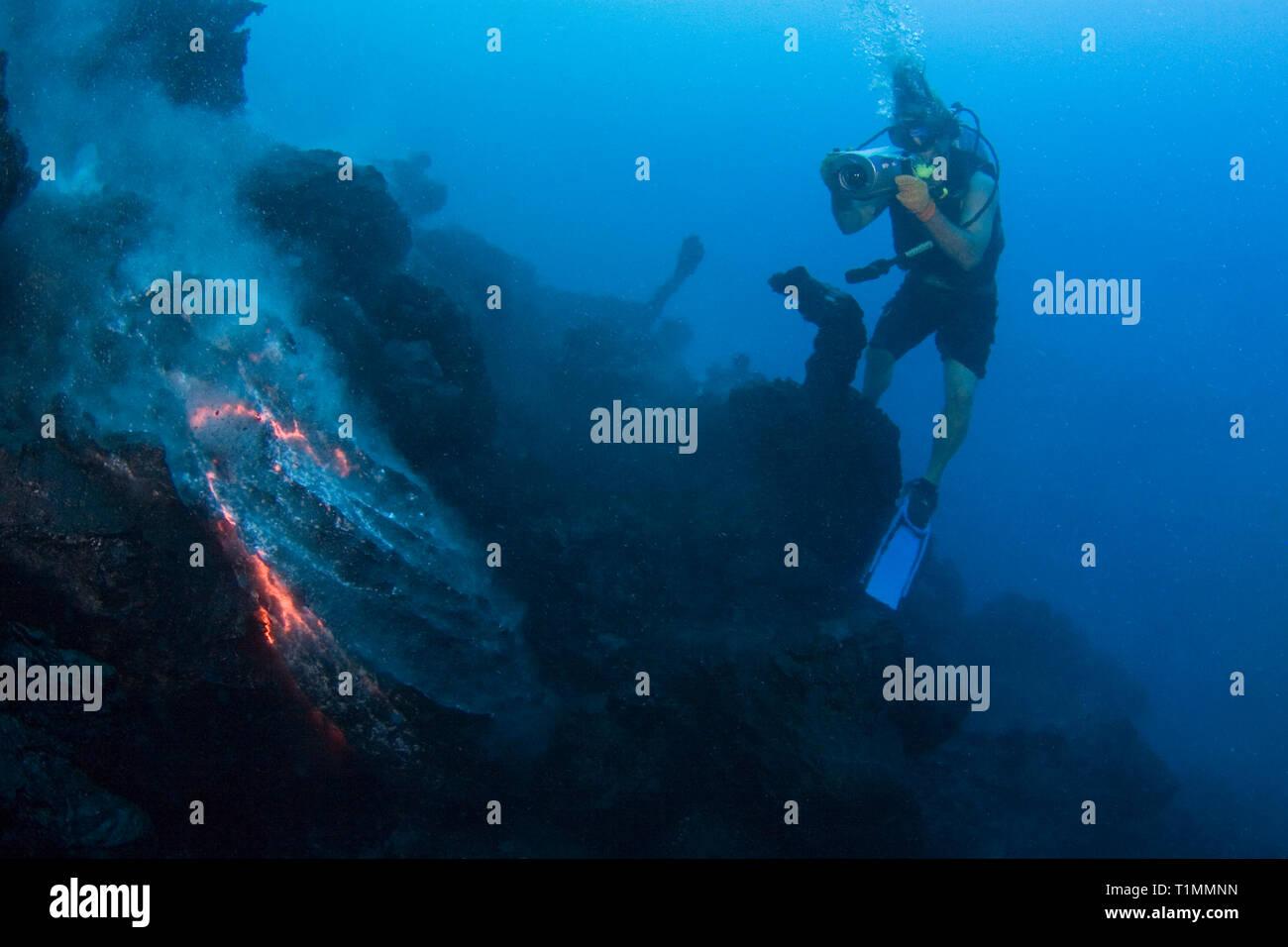videographer Shane Turpin films pillow lava at underwater eruption of Kilauea Volcano Hawaii Island ( the Big Island ) Hawaii U.S.A. ( Pacific Ocean ) Stock Photo
