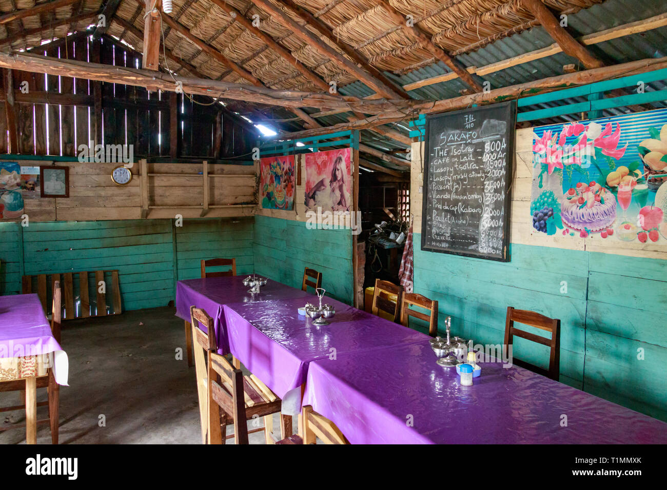 Andavadoaka Madagascar January 13th 2019 A Menu Written On A Blackboard On A Wall Wooden Chairs And Tables In A Rustic Restaurant In Central Mar Stock Photo Alamy