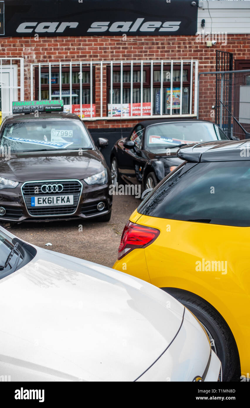 Tight photograph of Used Cars on sale at a Second Hand Car sales pitch at the side of the road - Stock Image