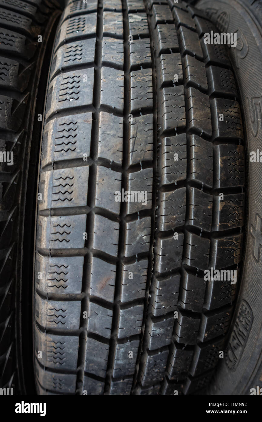 Closeup of a used car tyre ready for resale in a distribution centre - Stock Image
