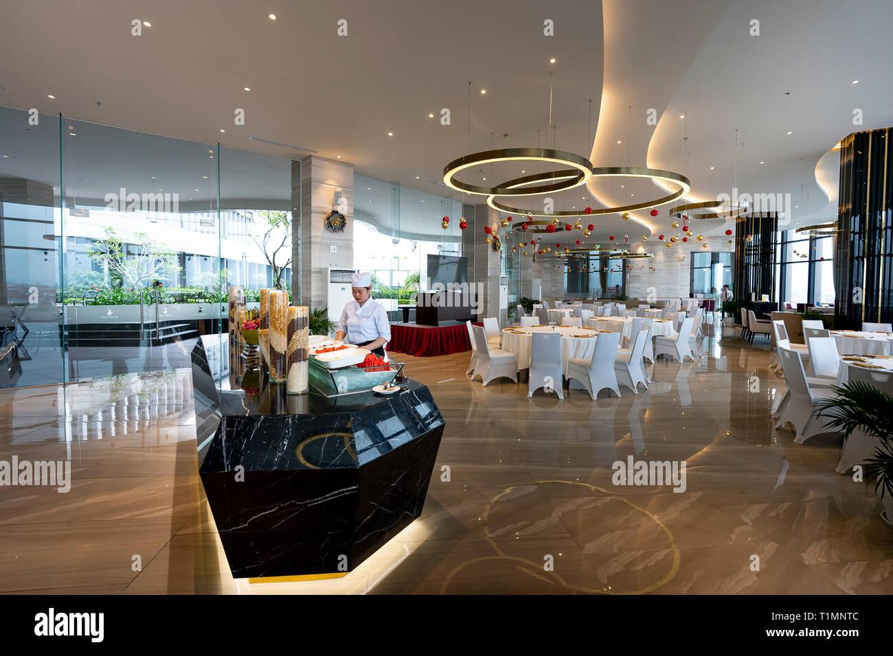Five-star hotel Vinpearl, Ha Tinh province, Vietnam - December 17, 2018: Restaurant interior of five-star Vinpearl hotel in Ha Tinh city, Ha Tinh prov - Stock Image