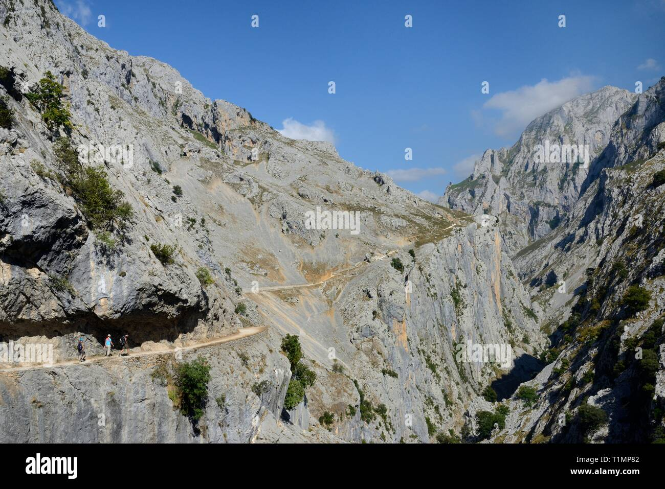 Three hikers on the Cares Gorge trail, Picos de Europa mountains, Asturias, Spain, August 2016. - Stock Image