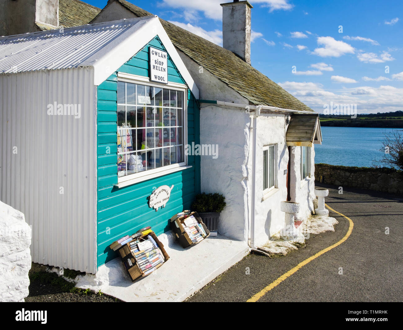 Wool shop and quaint tiny cottage in coastal village. Moelfre, Isle of Anglesey, Wales, UK, Britain Stock Photo