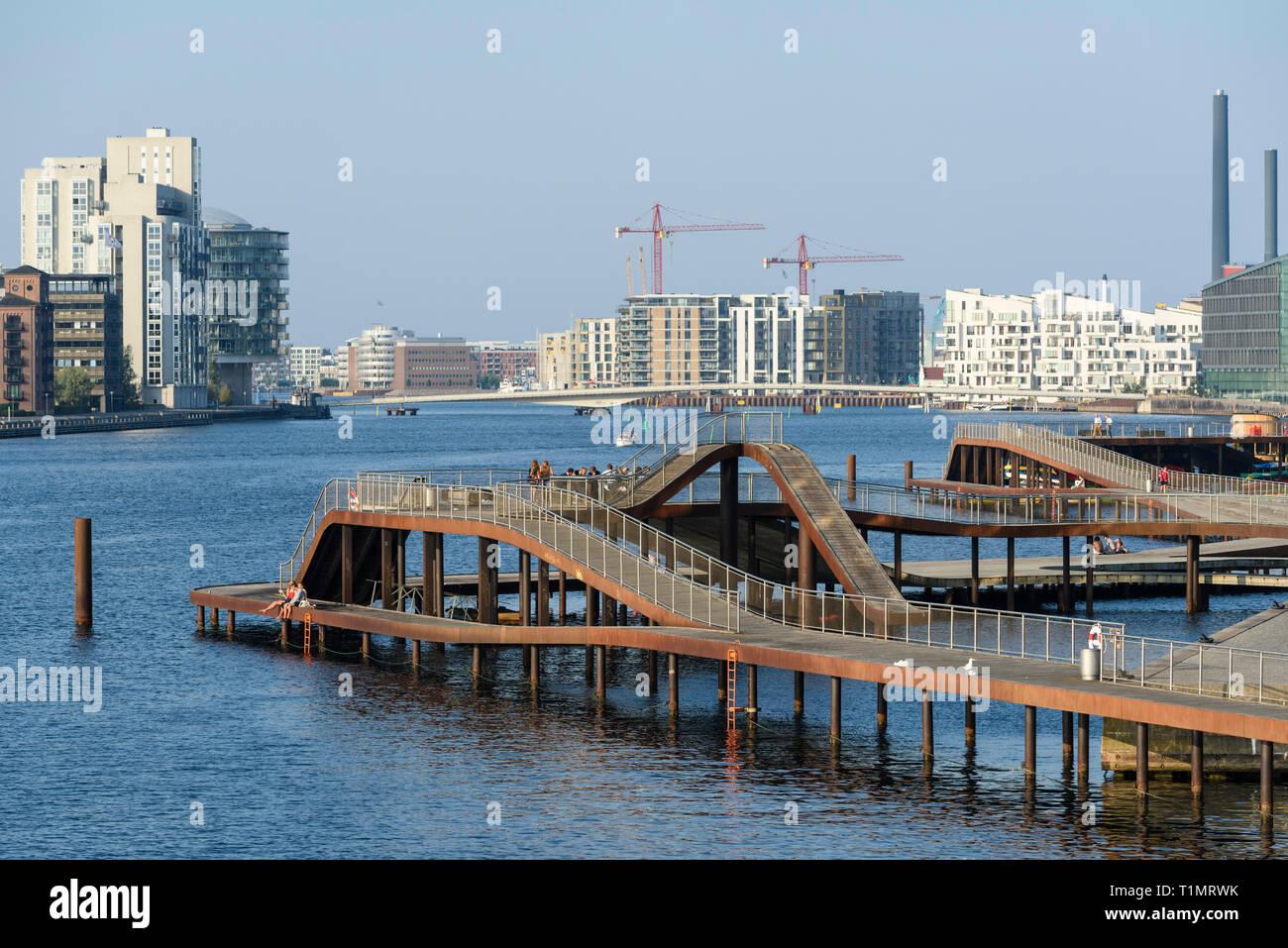 Copenhagen. Denmark. Kalvebod Bølge (Kalvebod Wave), harbour front promenade on Kalvebod Brygge waterfront.  The Kalvebod Wave was designed by JDS Arc - Stock Image