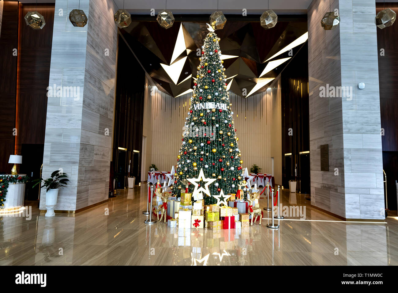 Five-star hotel Vinpearl, Ha Tinh province, Vietnam - December 17, 2018: Big pine tree prepared for Christmas in the reception hall of five-star Vinpe - Stock Image